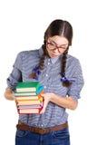Muchacha adolescente con los libros Foto de archivo libre de regalías
