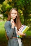 Muchacha adolescente con los libros en manos Foto de archivo libre de regalías