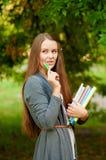 Muchacha adolescente con los libros en manos Imagenes de archivo