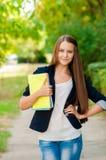 Muchacha adolescente con los libros en manos Fotos de archivo libres de regalías