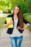 Muchacha adolescente con los libros en manos Imágenes de archivo libres de regalías
