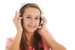 Muchacha adolescente con los teléfonos principales Imágenes de archivo libres de regalías