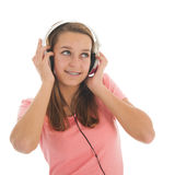 Muchacha adolescente con los teléfonos principales Imagen de archivo libre de regalías
