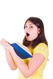Muchacha adolescente con mirada asustadiza en su cara Fotos de archivo