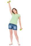 Muchacha adolescente con pesas de gimnasia Imágenes de archivo libres de regalías