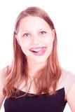 Muchacha adolescente con su lengua hacia fuera Fotografía de archivo libre de regalías