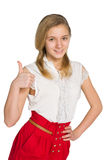 Muchacha adolescente con su pulgar para arriba Imagenes de archivo