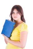 Muchacha adolescente con un libro Imágenes de archivo libres de regalías