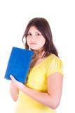 Muchacha adolescente con un libro Foto de archivo libre de regalías