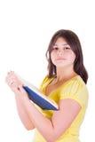 Muchacha adolescente con un libro Imagen de archivo libre de regalías