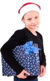 Muchacha adolescente con un regalo del Año Nuevo Imagen de archivo libre de regalías