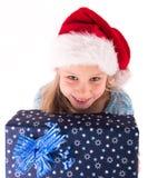Muchacha adolescente con un regalo del Año Nuevo Fotos de archivo