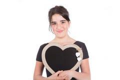 Muchacha adolescente con una pizarra Fotos de archivo