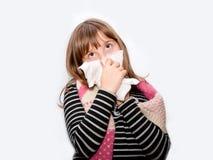 Muchacha adolescente de estornudo Fotografía de archivo libre de regalías