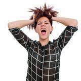 Muchacha adolescente de grito con las manos en pelo Foto de archivo libre de regalías