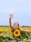 Muchacha adolescente de la belleza con el girasol Fotografía de archivo libre de regalías
