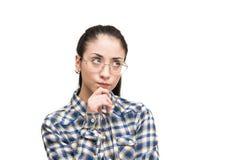 Muchacha adolescente de la expresión incierta de la cara que mira para arriba Fotografía de archivo libre de regalías