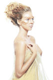 Muchacha adolescente de la moda del oro Foto de archivo