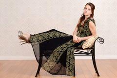 Muchacha adolescente de la moda en banco Fotografía de archivo libre de regalías