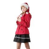 Muchacha adolescente de la Navidad bonita en el sombrero de santa Imágenes de archivo libres de regalías