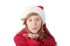 Muchacha adolescente de la Navidad bonita en el sombrero de santa Imagen de archivo
