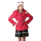 Muchacha adolescente de la Navidad bonita en el sombrero de santa Foto de archivo libre de regalías