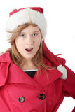 Muchacha adolescente de la Navidad bonita en el sombrero de santa Fotos de archivo libres de regalías