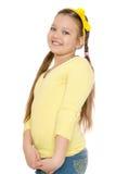 Muchacha adolescente de pelo largo con las coletas en su cabeza Imagenes de archivo