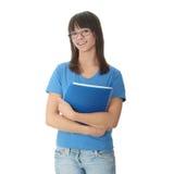 Muchacha adolescente del estudiante con la pista de nota Foto de archivo