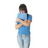 Muchacha adolescente del estudiante con la pista de nota Foto de archivo libre de regalías