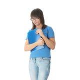 Muchacha adolescente del estudiante con la pista de nota Fotos de archivo