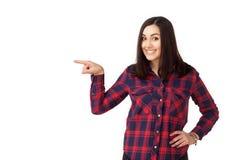 Muchacha adolescente del estudiante que señala al lado Fotografía de archivo