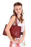 Muchacha adolescente del retrato con un monedero Fotografía de archivo