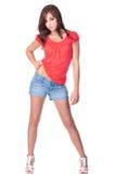 Muchacha adolescente delgada en rojo y azul Imágenes de archivo libres de regalías