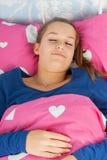 Muchacha adolescente durmiente Fotografía de archivo libre de regalías