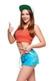 Muchacha adolescente emocionada que mide su cintura Fotos de archivo