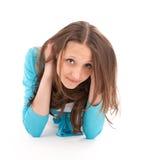 Muchacha adolescente en alineada azul Fotos de archivo libres de regalías