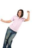Muchacha adolescente en camiseta y pantalones vaqueros en blanco Fotos de archivo