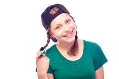 Muchacha adolescente en el casquillo que se divierte Foto de archivo