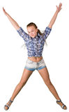 Muchacha adolescente en el salto de los pantalones cortos aislada en el fondo blanco Imagen de archivo
