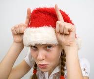 Muchacha adolescente en el sombrero de Santa Fotografía de archivo libre de regalías