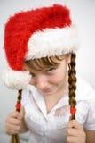 Muchacha adolescente en el sombrero de Santa Imagen de archivo