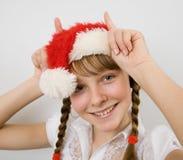 Muchacha adolescente en el sombrero de Santa Fotos de archivo libres de regalías