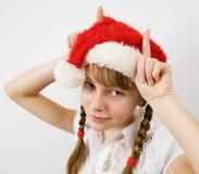 Muchacha adolescente en el sombrero de Santa Foto de archivo
