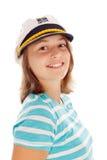Muchacha adolescente en el sombrero del capitán Imagen de archivo