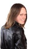 Muchacha adolescente en la chaqueta de cuero Fotos de archivo