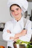 Muchacha adolescente en la cocina Imagenes de archivo