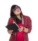 Muchacha adolescente en rojo con la tableta en el fondo blanco. Fotos de archivo libres de regalías