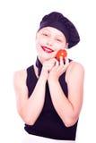 Muchacha adolescente en sombrero del cocinero con los tomates Fotografía de archivo