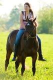 Muchacha adolescente en su caballo Imágenes de archivo libres de regalías